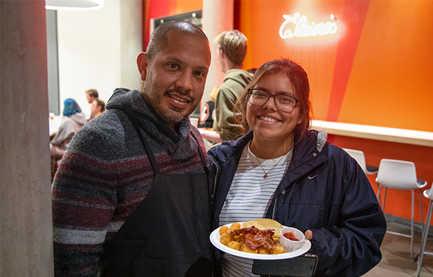 Negrete with an Otis College student during Moonlight Breakfast in 2019.