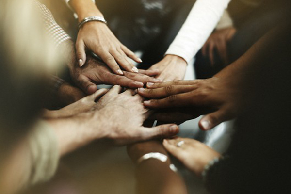 Picture of hands together- representing teamwork