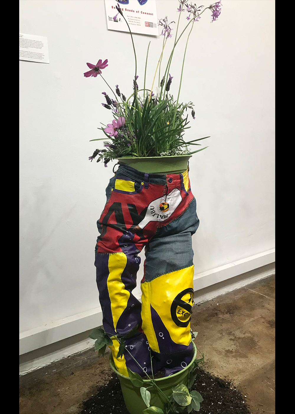 One of a group of sculpture installations made in collaboration with RAINN, for sexual assault awareness at their Denim Day event. I took apart, painted, and restitched a pair of pants to tell the story of pulling yourself back together after abuse. The group each mounted their pants to stand upright, and filled with planters, to convey the idea of growth and beauty after pain. Jessica Perkins, Jasper Perkins, Immerzart, installation, RAINN, denim day, consent, awareness sculpture, plants,