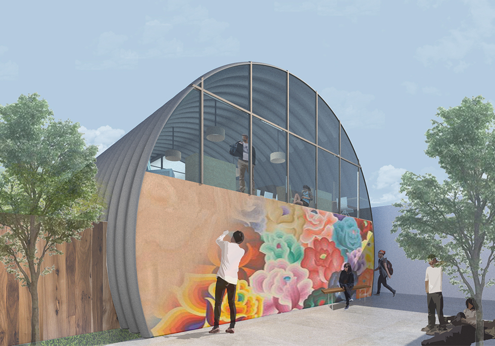 This image depicts the exterior of the homeless youth shelter where people are hanging out outside as a man paints a mural on the end wall of the quonset hut.