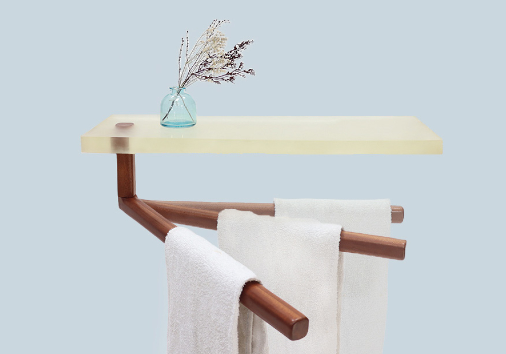 a rotating teak towel holder caught in a still current of resin.