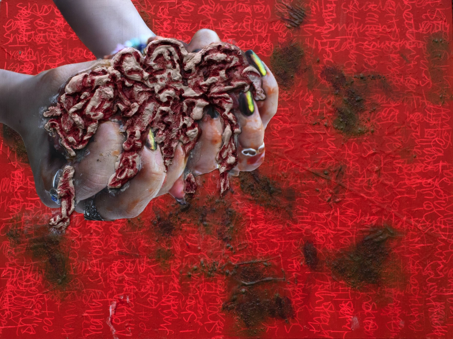 Red panel with collaged hands, holding expanding foam object.