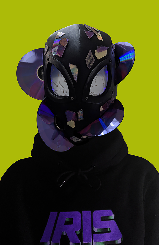 Black plastic helmet made of plastic folder, broken CDs, and LED lights.