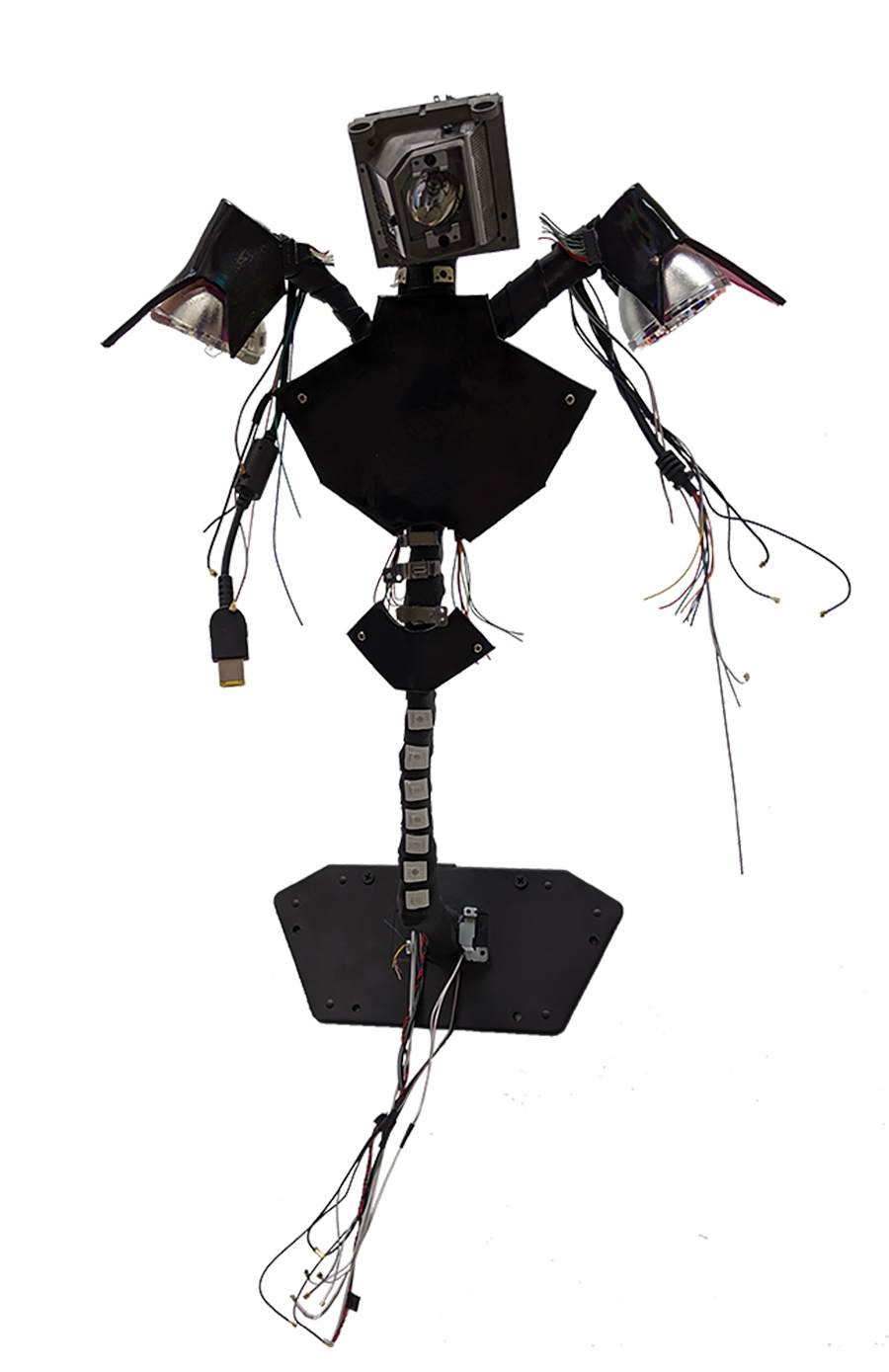 Sculpture in arranged humanistic form made of LED strips, wires, laptop charger, Worbla thermoplastic, EVA foam, plastic utensils, projector bulbs, stretch pleather, and small computer parts.