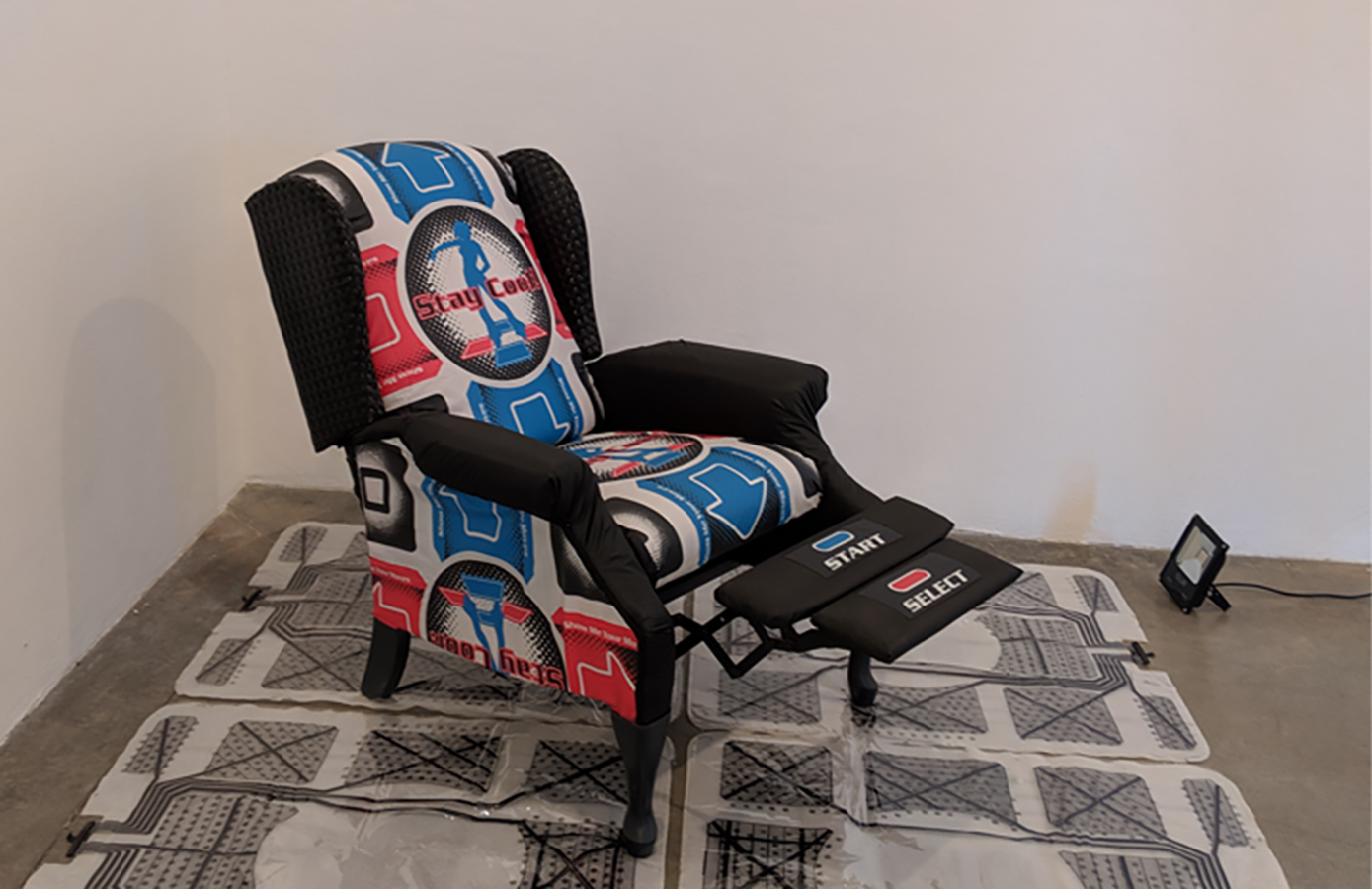 Thrifted recliner reupholstered with Dance Dance Revolution dance mats, and stretch Pleather fabric.