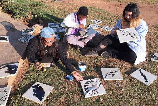 Students create tiles for a life-sized chess board.