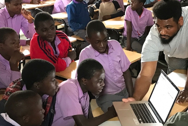 Students hearing from Otis students at the Jacaranda School