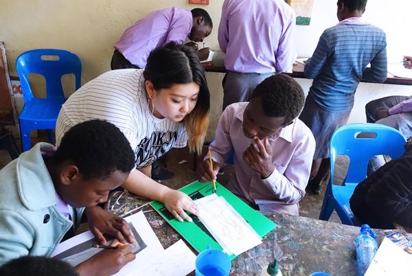 Students learning the basics of fashion illustration.