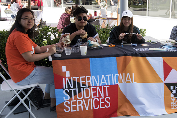 International Students at a desk