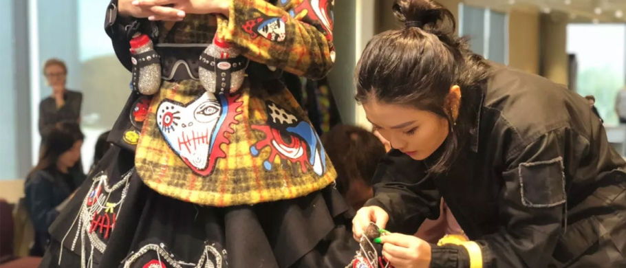 Jinny Song in a fitting for her runway look