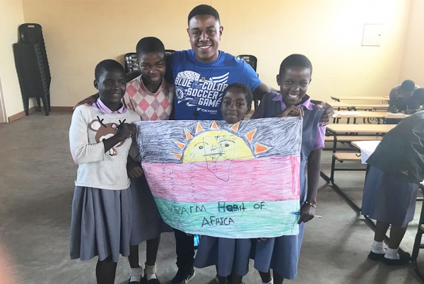 Noah Humes with a group of students from the Jacaranda School