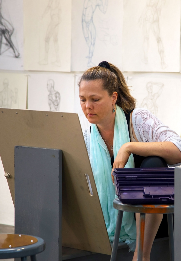 Woman sketching on drawing board