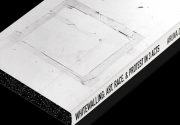 Aruna D'Souza's book 'Whitewalling: Art, Race, and Protest in 3 Acts' with a black background
