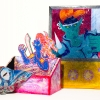 Inspired by my nostalgia for childhood fantasy card games, this installation consists of a mixed media card painting, booster pack display box, and fabric booster pack.