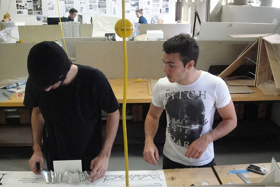 Thomas Acosta and Carlos Salazar collaborating on competition entry