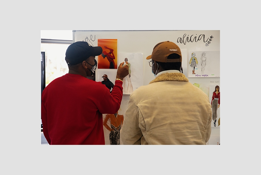 Jason Bolden reviews a Summer of Style student's work at Otis College.
